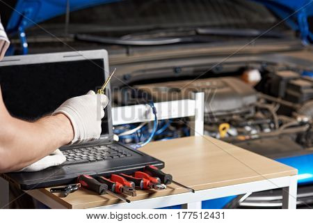 Closeup Of Car Mechanic Hands