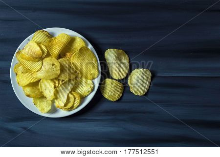 potatoes and potato products, fried potato slices, potato slices fried serrated, fried potato flakes in a furnace,