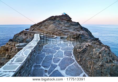 the narrow path that leads at the church of Seven Martyrs behind the mountain Sifnos Greece