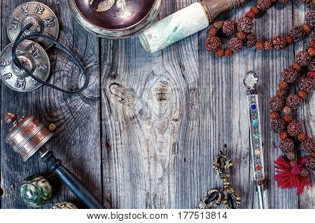 religion ethnic objects for meditation and relaxation: singing bowl strike plates drums beads and two balls top view