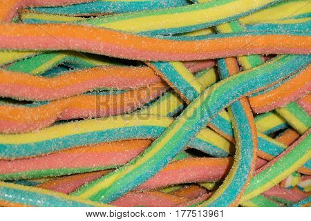 Multicolored sweet marmalade candies sprinkled with sugar