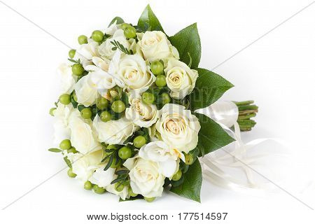 White roses and green hypericum berries bridal bouquet