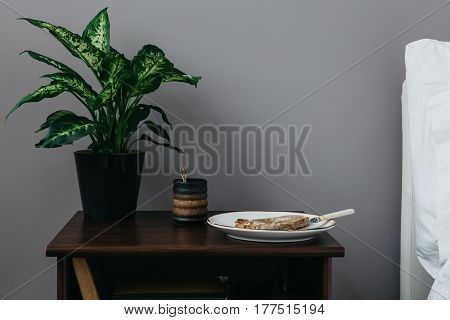 Breakfast of Tea and Toast on Bedside Table in Bedroom