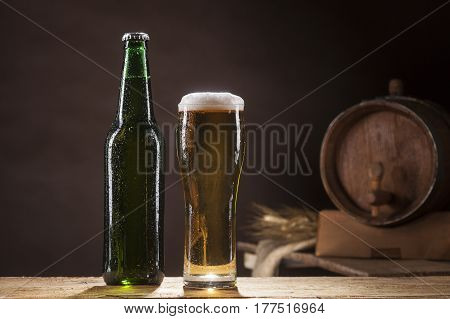 Beer Barrel With Bottle And Mug On Brown Background
