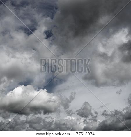 Moody dramatic cloudy sky. Clouds flying over horizon cloudscape.
