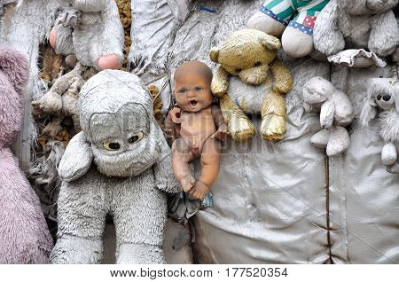 Old forgotten children's soft toys, teddy bears, dolls