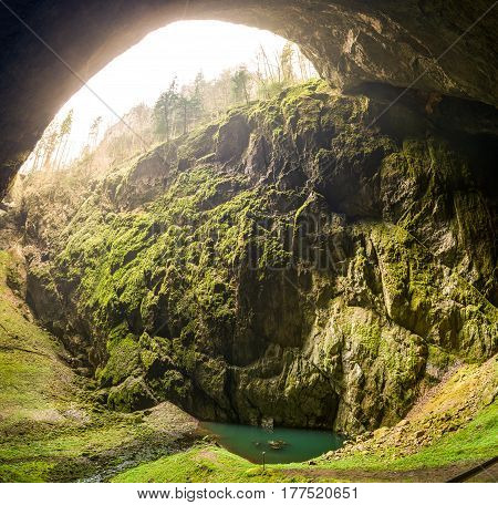The Macocha Abyss also known as the Macocha Gorge is a sinkhole in the Moravian Karst cave system of the Czech Republic located north of the city of Brno near the town of Blansko.