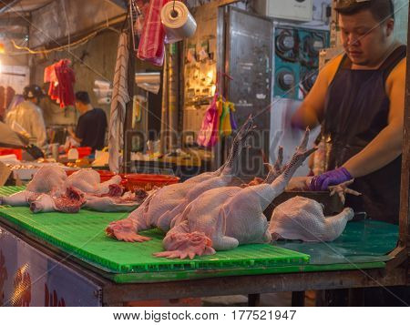 Taipei Taiwan - October 12 2016: Hens with heads and feet on a local market in New Taipei City