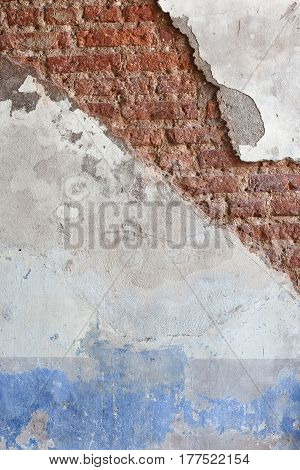 Broken wall background with dirty plaster and old brick. Vintage surface texture. Design of loft grunge surface.