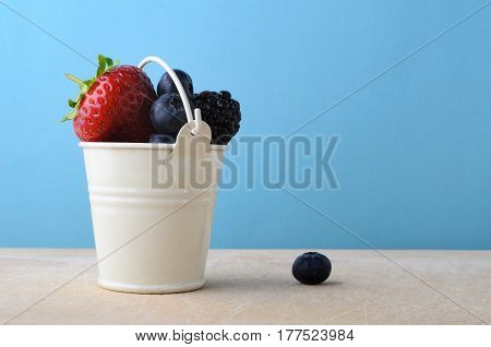 Metal Bucket Filled Up With Fresh Fruit Berries