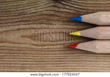 Pencils In Primary Colours On Wood