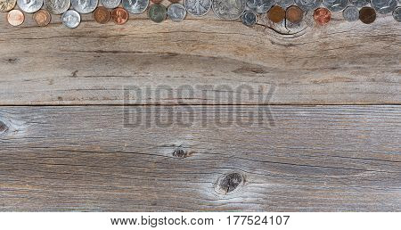 Overhead view of a top border of partial United States vintage coin money on rustic wood