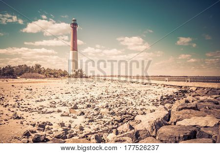 Barnegat Lighthouse along the Atlantic Ocean in New Jersey, retro look