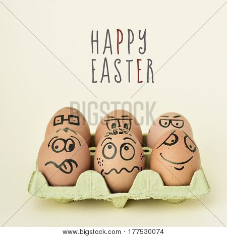 a pile of brown eggs ornamented with funny faces in a yellow egg carton, and the text happy easter on an off-white background