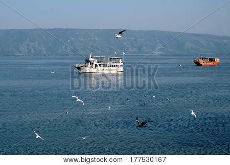 TIBERIAS ISRAEL - FEBRUARY 26 2017: Pleasure boats on the Sea of Galilee opposite Tiberias