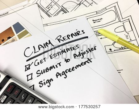 Insurance claim lost of things to do in a claim to get paid for claims settlement with checklist and words adjuster,repairs,agreement on desk with blueprints and calculator for loss items or home insurance repairs