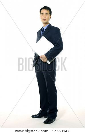 business man holding a laptop