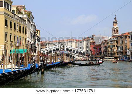 Travel To Venice, Italy. The Gondolas On The Venetian Canal Near To Ponte Di Rialto.
