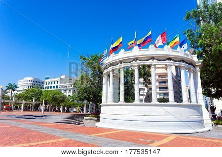 Latin American flags waving in a plaza in Guayaquil Ecuador