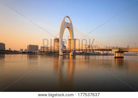 Modern bridge in Zhujiang River and modern building of financial district in guangzhou city China