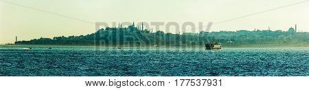 Panorama of the Golden Horn with Topkapi in the misty evening, Istanbul, Turkey,