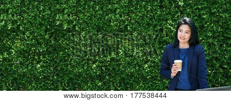 Businesswoman Working Outside Office Green Leaf Wall,business On Go And Using Digital Technology Dev