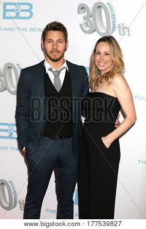 LOS ANGELES - MAR 19:  Scott Clifton, Nicole Lampson at the