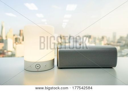 glow smart portable music speaker light with wireless bluetooth speaker on table