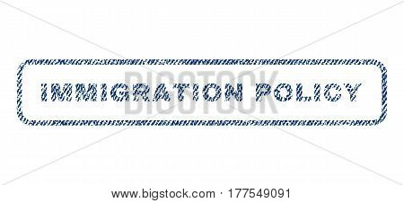 Immigration Policy text textile seal stamp watermark. Blue jeans fabric vectorized texture. Vector caption inside rounded rectangular banner. Rubber sticker with fiber textile structure.