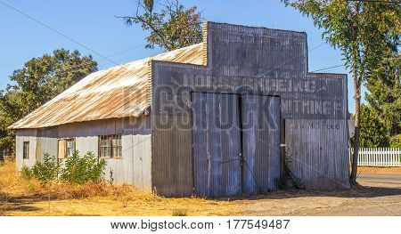 Vintage Corrugated Tin Building With Rusty Roof