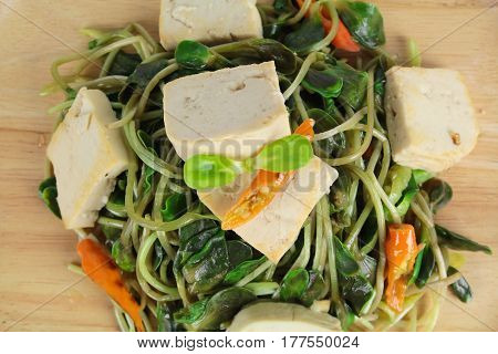fried sunflower sprout with sauce and tofu, thai style