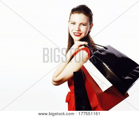 young pretty smiling woman in red dress with bags on shopping isolated on white background, lifestyle real people concept close up