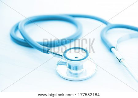 Blue stethoscope medical or science with soft light background