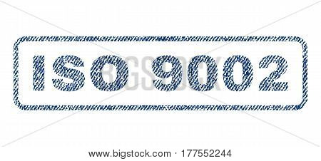 ISO 9002 text textile seal stamp watermark. Blue jeans fabric vectorized texture. Vector tag inside rounded rectangular banner. Rubber sign with fiber textile structure.