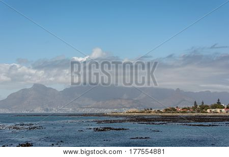 Cape Town and Table Mountain as seen from the Robben Island harbour