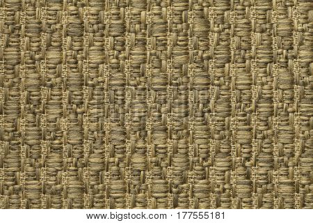 Golden knitted woolen background with a pattern of soft fleecy cloth. Texture of yellow textile closeup.