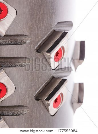 Milling head for wood processing, macro photo cutters close, isolated on a white background