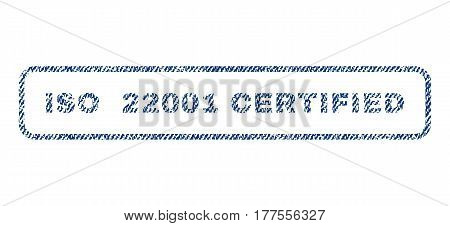 ISO 22001 Certified text textile seal stamp watermark. Blue jeans fabric vectorized texture. Vector tag inside rounded rectangular shape. Rubber sticker with fiber textile structure.