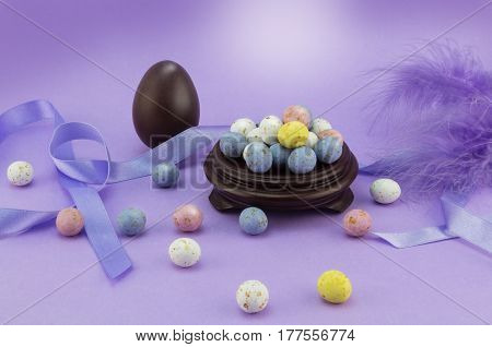Lilac easter egg background with many speckled eggs