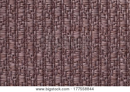 Dark brown knitted woolen background with a pattern of soft fleecy cloth. Texture of textile closeup.