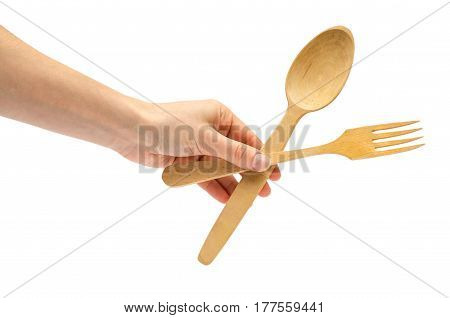 Hand Of Young Girl Holding Spoon And Fork.