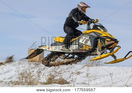 Tyumen, Russia - March 08. 2008: IV stage of personal-team Championship of Ural Federal district in over-snow cross-country. Flying sportsman on snowmobile