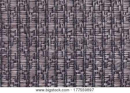 Dark gray knitted woolen background with a pattern of soft fleecy cloth. Texture of brown textile closeup.