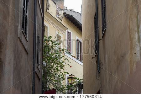 view of a glimpse of an alley in the historic town centre of Rome