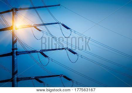 High voltage tower isolated on skyblue toned.