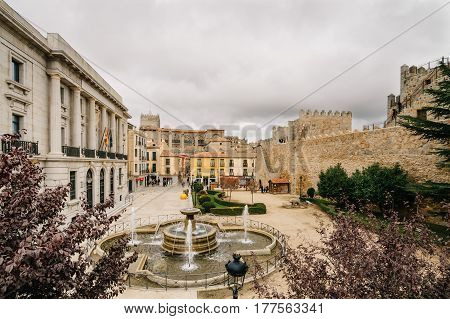 Avila Spain - November 11 2014: The Medieval Walls of Avila cathedral and square. The old city and its extramural churches were declared a World Heritage site by UNESCO