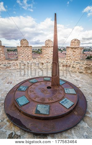 Avila Spain - November 11 2014: Metal Sundial in The Medieval Walls of Avila. The old city and its extramural churches were declared a World Heritage site by UNESCO