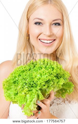 Portrait of very beautiful woman holding fresh lettuce, green salad and looking at us. Studio shot isolated on white background. Healthy eating concept.