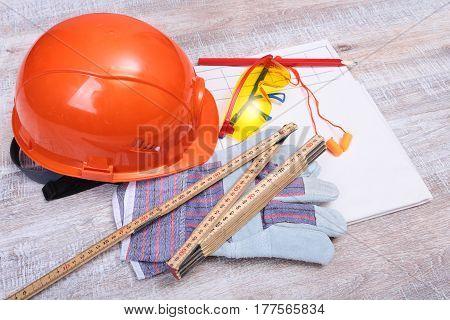 Orange earplug , hard hat, safety glasses, gloves. Earplug to reduce noise on a white background ..