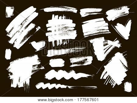 Brush grungy vector abstract hand-painted background. Grunge Brush Stroke. Modern Textured Brush Stroke on a black background. Set
